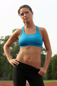 Young Woman in Sports Bra with Hands on Hips