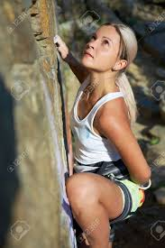blonde rock climbing